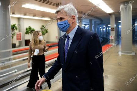 Senator Bill Cassidy, R-LA, walks on Capitol Hill in Washington,, before the fifth day of the second impeachment trial of former President Donald Trump.