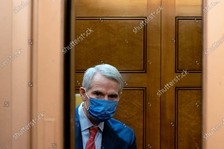 Senator Rob Portman, a Republican from Ohio, wears a protective mask while arriving to the U.S. Capitol in Washington, D.C., U.S.,. The Senate approved 55-45 a request to consider calling witnesses in the second impeachment trial of Donald Trump, a move that may extend the trial that was expected to end within hours.