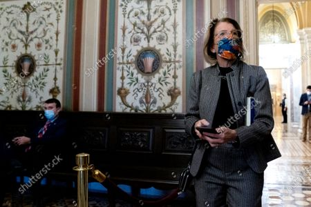 Senator Shelley Moore Capito, a Republican from West Virginia, wears a protective mask while walking through the U.S. Capitol in Washington, D.C., U.S.,. The Senate voted to consider a request for witnesses at Donald Trump's impeachment trial, injecting a chaotic new element that could end up prolonging proceedings that appeared to be on track to wrap up today.