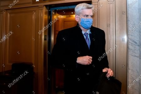 Senator Bill Cassidy, a Republican from Louisiana, wears a protective mask while departing the U.S. Capitol in Washington, D.C., U.S.,. Donald Trump's second impeachment trial ended in a not guilty verdict on a vote of 57-43, short of the two-thirds majority required.