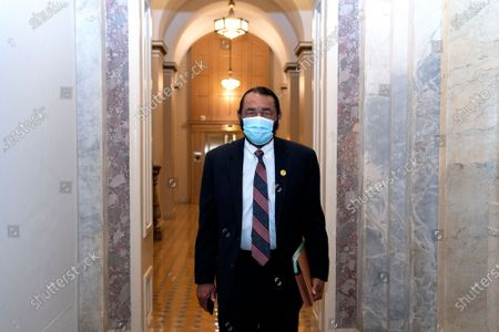 United States Representative Al Green (Democrat of Texas), wears a protective mask while walking through the U.S. Capitol in Washington, D.C., U.S.,. Donald Trump's second impeachment trial ended in a not guilty verdict on a vote of 57-43, short of the two-thirds majority required.