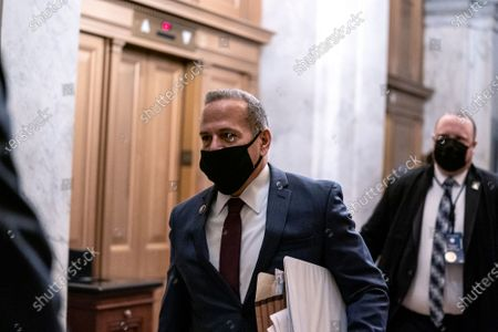 Representative David Cicilline a Democrat from Rhode Island, wears a protective mask while arriving to the U.S. Capitol in Washington, D.C., U.S.,. The Senate approved 55-45 a request to consider calling witnesses in the second impeachment trial of Donald Trump, a move that may extend the trial that was expected to end within hours.
