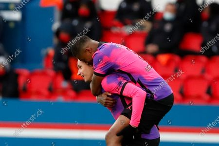 PSG's Julian Draxler, left, and his teammate PSG's Presnel Kimpembe celebrates after scoring his side's first goal, during the French League One soccer match between Paris Saint Germain and Nice, at the Parc des Princes stadium in Paris, France