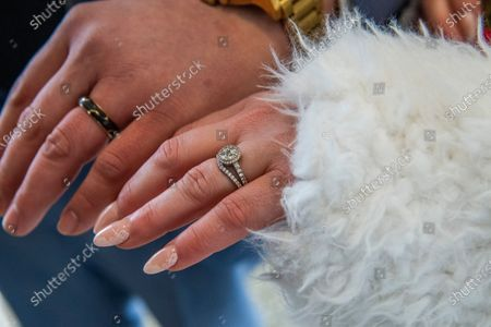 Kristine Mariana and Jorge Martinez show their David Yurman wedding bands after getting married at the Empire State Building, in New York. After getting engaged at the Empire State Building in 2018, the couple put their wedding on hold because of COVID-19. They were selected earlier in the week to hold their wedding at the same place where they were engaged