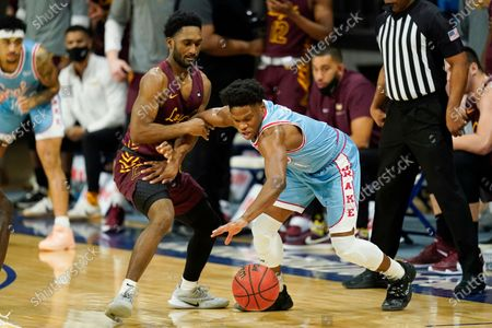 Stock Picture of Drake guard Joseph Yesufu fights for a loose ball with Loyola of Chicago guard Keith Clemons, left, during the first half of an NCAA college basketball game, in Des Moines, Iowa