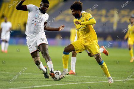 Stock Photo of Al-Nassr's player Sami Al-Najei (R) in action against Al-Shabab's Alfred N'Diaye (L) during the Saudi Professional League soccer match between Al-Nassr and Al-Shabab at King Saud University Stadium, in Riyadh, Saudi Arabia, 13 February 2021.