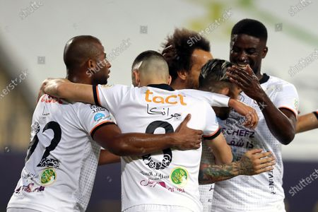 Al-Shabab's player Ever Banega (2-R) celebrates with teammates after scoring a goal during the Saudi Professional League soccer match between Al-Nassr and Al-Shabab at King Saud University Stadium, in Riyadh, Saudi Arabia, 13 February 2021.