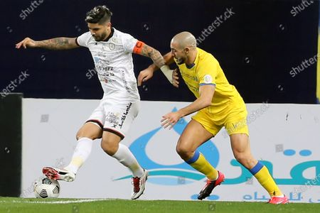 Al-Nassr's player Nordin Amrabat (R) in action against Al-Shabab's Ever Banega (L) during the Saudi Professional League soccer match between Al-Nassr and Al-Shabab at King Saud University Stadium, in Riyadh, Saudi Arabia, 13 February 2021.