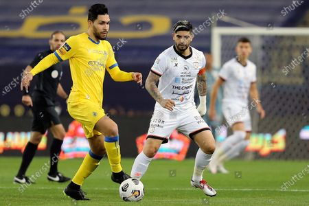 Al-Nassr's player Petros (L) in action against Al-Shabab's Ever Banega (R) during the Saudi Professional League soccer match between Al-Nassr and Al-Shabab at King Saud University Stadium, in Riyadh, Saudi Arabia, 13 February 2021.
