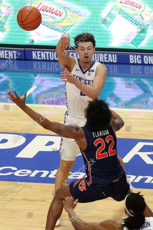 Stock Picture of Kentucky's Devin Askew, top, passes over Auburn's Allen Flanigan (22) during the second half of an NCAA college basketball game in Lexington, Ky