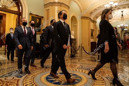 House Impeachment managers including (L to R) Rep. Ted Lieu (D-CA), Rep. David Cicilline (D-RI), Rep. Eric Salwell (D-CA), Rep. Joe Neguse (D-CO) and Lead Impeachment Manager Rep. Jamie Raskin (D-MD) walk out of the Senate Chamber at the U.S. Capitol Building on Saturday, Feb. 13, 2021 in Washington, DC. By a vote of 57 to 43, the Senate acquitted former President Donald Trump. (Kent Nishimura / Los Angeles Times)