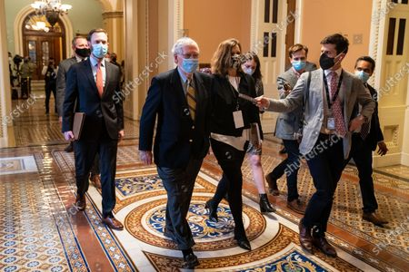 Senate Minority Leader Mitch McConnell (R-KY) walks to his office in the U.S. Capitol Building on Saturday, Feb. 13, 2021 in Washington, DC. By a vote of 57 to 43, the Senate acquitted former President Donald Trump. (Kent Nishimura / Los Angeles Times)