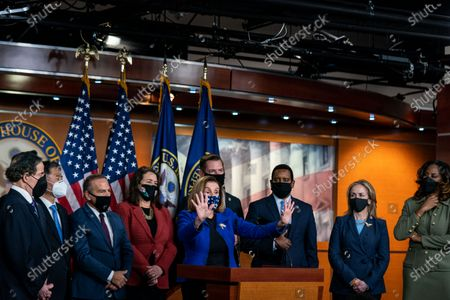 With House Impeachment Managers behind her, Speaker of the House Nancy Pelosi (D-CA) speaks during a press conference on Capitol Hill on Saturday, Feb. 13, 2021 in Washington, DC. By a vote of 57 to 43, the Senate acquitted former President Donald Trump. (Kent Nishimura / Los Angeles Times)