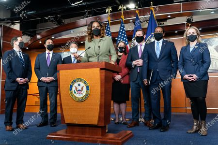 House Impeachment Manager Del. Stacey Plaskett (D-VI), center, speaks during a press conference at the U.S. Capitol Building on Saturday, Feb. 13, 2021 in Washington, DC. By a vote of 57 to 43, the Senate acquitted former President Donald Trump. (Kent Nishimura / Los Angeles Times)