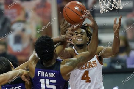 Texas forward Greg Brown (4) and TCU forward Terren Frank (15) battle for control of a rebound during the first half of an NCAA college basketball game, in Austin, Texas