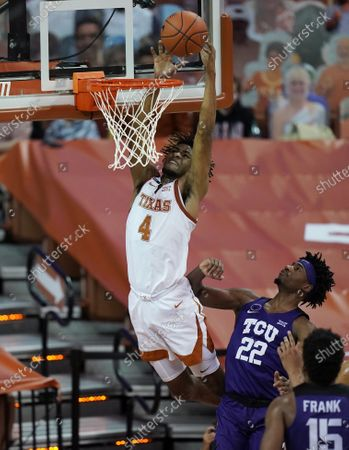 Texas forward Greg Brown (4) drives to the basket over TCU guard RJ Nembhard (22) during the second half of an NCAA college basketball game, in Austin, Texas