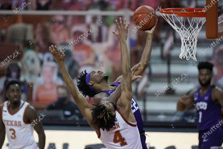 Guard RJ Nembhard (22) drives to the basket against Texas forward Greg Brown (4) during the second half of an NCAA college basketball game, in Austin, Texas