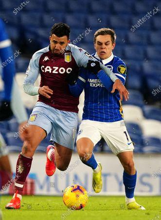 Mahmoud Hassan of Aston Villa and Leandro Trossard of Brighton & Hove Albion.