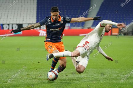 Montpellier's Pedro Mendes, left, and Lyon's Mattia De Sciglio fight for the ball during the French League One soccer match between Lyon and Montpellier in Decines, near Lyon, central France