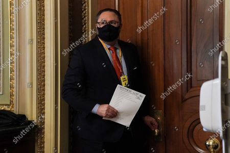 Stock Picture of Jason Miller, advisor to former President Donald Trump, carriers a witness list to the Senate Chamber on during the fifth day of the impeachment trial of former President Donald Trump at the U.S. Capitol in Washington DC,