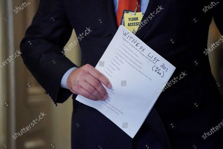 Jason Miller, advisor to former President Donald Trump, carriers a witness list to the Senate Chamber on during the fifth day of the impeachment trial of former President Donald Trump at the U.S. Capitol in Washington DC,