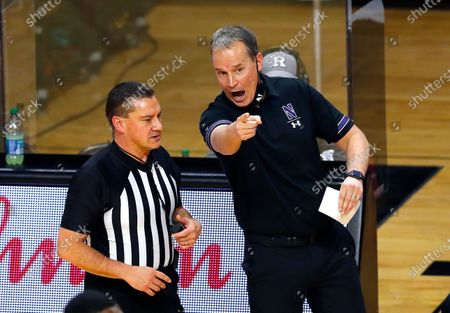 Northwestern head coach Chris Collins, right, talks to a referee during the first half of an NCAA college basketball game against Rutgers in Piscataway, N.J