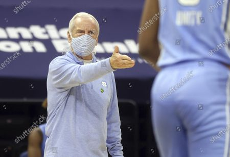 North Carolina coach Roy Williams talks with his players during the team's NCAA college basketball game against Virginia, in Charlottesville, Va
