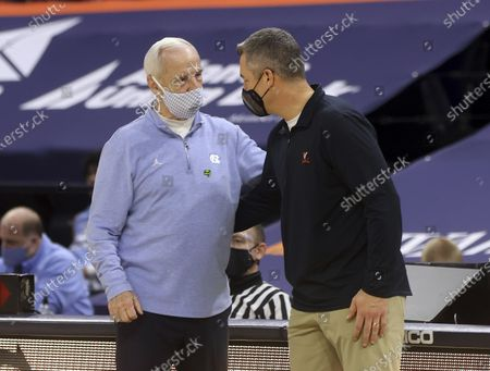 Virginia coach Tony Bennett, right, greets North Carolina coach Roy Williams after an NCAA college basketball game, in Charlottesville, Va