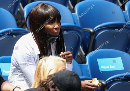 Venus Williams watches her sister Serena on Rod Laver Arena in her fourth round match against Aryna Sabalenka at the Australian Open tennis championship in Melbourne, Australia