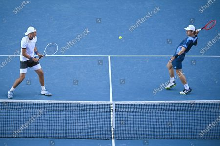 Lukasz Kubot (R) of Poland and Wesley Koolhof of the Netherlands in action during their second Round Men's doubles match against Nick Kyrgios and Thanasi Kokkinakis of Australia on Day 7 of the Australian Open at Melbourne Park in Melbourne, Australia, 14 February 2021.