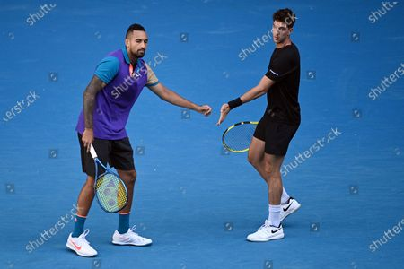 Nick Kyrgios (L) and Thanasi Kokkinakis of Australia in action during their second Round Men's doubles match against Lukasz Kubot of Poland and Wesley Koolhof of the Netherlands on Day 7 of the Australian Open at Melbourne Park in Melbourne, Australia, 14 February 2021.