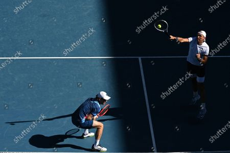 Lukasz Kubot of Poland (R) and Wesley Koolhof of the Netherlands in action during their second Round Men's doubles match against Nick Kyrgios and Thanasi Kokkinakis of Australia on Day 7 of the Australian Open at Melbourne Park in Melbourne, Australia, 14 February 2021.