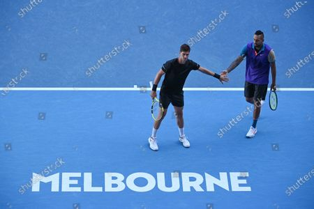 Nick Kyrgios (R) and Thanasi Kokkinakis of Australia in action during their second Round Men's doubles match against Lukasz Kubot of Poland and Wesley Koolhof of the Netherlands on Day 7 of the Australian Open at Melbourne Park in Melbourne, Australia, 14 February 2021.