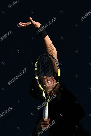 Thanasi Kokkinakis of Australia serves during his second Round Men's doubles match with Nick Kyrgios of Australia against Lukasz Kubot of Poland (R) and Wesley Koolhof of the Netherlands on Day 7 of the Australian Open at Melbourne Park in Melbourne, Australia, 14 February 2021.