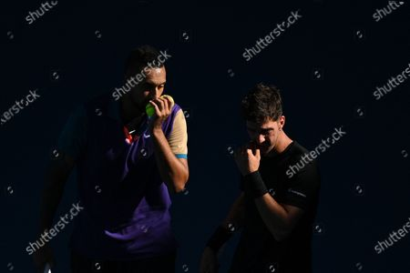Nick Kyrgios (L) and Thanasi Kokkinakis of Australia talk tactics during their second Round Men's doubles match against Lukasz Kubot of Poland and Wesley Koolhof of the Netherlands on Day 7 of the Australian Open at Melbourne Park in Melbourne, Australia, 14 February 2021.