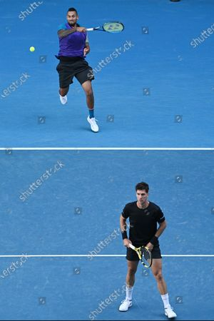 Nick Kyrgios (top) and Thanasi Kokkinakis of Australia in action during their second Round Men's doubles match against Lukasz Kubot of Poland and Wesley Koolhof of the Netherlands on Day 7 of the Australian Open at Melbourne Park in Melbourne, Australia, 14 February 2021.