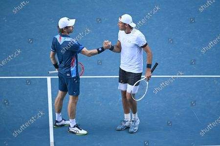Lukasz Kubot (R) of Poland and Wesley Koolhof of the Netherlands icelebrate winning their second Round Men's doubles match against Nick Kyrgios and Thanasi Kokkinakis of Australia on Day 7 of the Australian Open at Melbourne Park in Melbourne, Australia, 14 February 2021.
