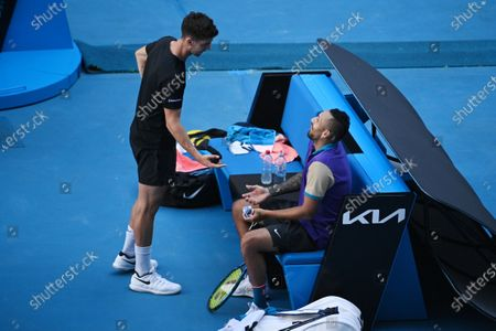 Nick Kyrgios (R) and Thanasi Kokkinakis of Australia after losing during their second Round Men's doubles match against Lukasz Kubot of Poland and Wesley Koolhof of the Netherlands on Day 7 of the Australian Open at Melbourne Park in Melbourne, Australia, 14 February 2021.