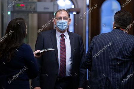 Sen. John Boozmanm, R-Ark., arrives at the U.S. Capitol for the impeachment trial of former President Donald Trump