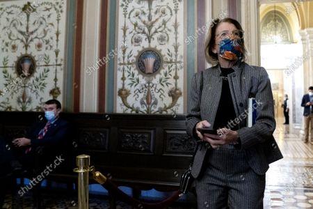 Senator Shelley Moore Capito, R-W.Va., walks through the U.S. Capitol during the impeachment trial of former President Donald Trump