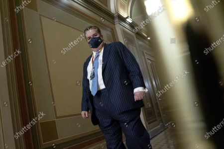 Stock Picture of William J. Brennan, defense attorney for Donald Trump, wears a protective mask while walking through the U.S. Capitol
