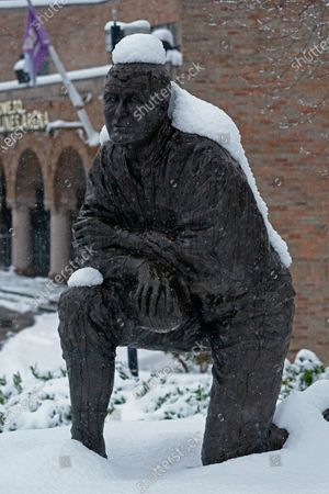 Stock Picture of The statue of former Washington NCAA college football coach Jim Owens wears a coating of snow, in Seattle. Winter weather was expected to continue through the weekend in the region