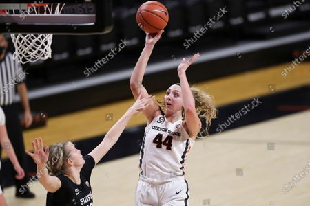 Oregon State's Taylor Jones (44) shoots over Stanford's Alyssa Jerome during the first half of an NCAA college basketball game in Corvallis, Ore