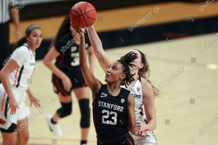 Stanford's Kiana Williams (23) drives to the basket past Oregon State's Taylor Jones, back, during the second half of an NCAA college basketball game in Corvallis, Ore