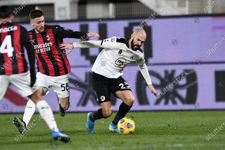 Riccardo Saponara of AC Spezia in action against Theo Hernandez of AC Milan
