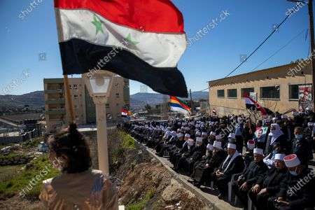 Stock Picture of Druse supporters of Syrian President Bashar Assad wave Syrian flags during a rally close to the Syrian border demanding the return of the Golan Heights, captured by Israel in 1967, in Majdal Shams, Golan Heights, . The annual demonstration is in protest of the 1981 Israeli law in which the Jewish state annexed the strategic plateau it captured from Syria during the 1967 Arab-Israeli war