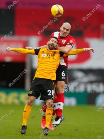 Wolverhampton Wanderers' Joao Moutinho and Southampton's Oriol Romeu challenge for the ball during the English Premier League soccer match between Wolverhampton Wanderers and Southampton at St. Mary's Stadium in Southampton, England, Sunday, Feb.14, 2021