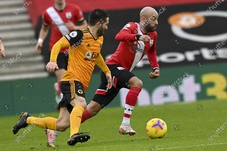 Nathan Redmond (R) of Southampton in action against Joao Moutinho (L) of Wolverhampton during the English Premier League soccer match between Southampton FC and Wolverhampton Wanderers in Southampton, Britain, 14 February 2021.