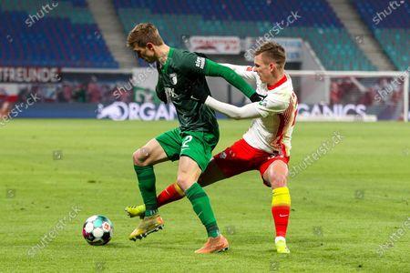 Robert Gumny #2 (FC Augsburg) and Daniel Carvajal #25 (RB Leipzig