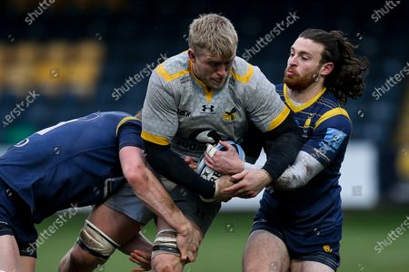 Stock Photo of Ben Morris of Wasps is tackled by Ted Hill and Oli Morris of Worcester Warriors